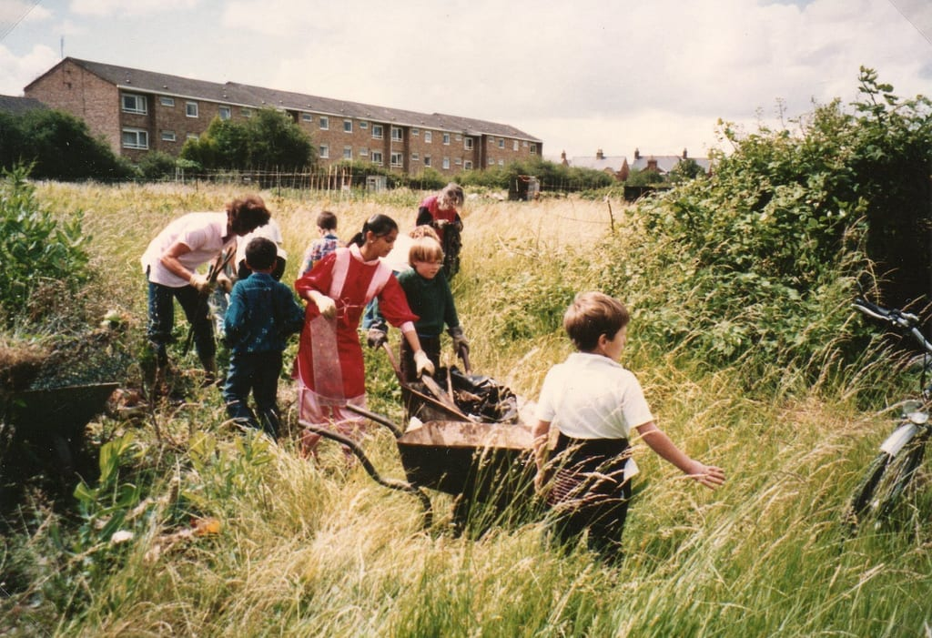 Local children help with clearing land, Summer 1991
